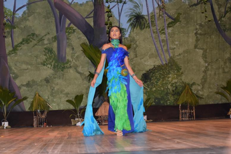 Sherryanna Balkaran displays her humming bird themed evening gown