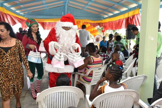 Santa and his helper sharing treats to the children