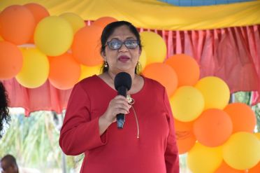 Mrs. Sita Nagamootoo delivering remarks to the guests at the annual Christmas party