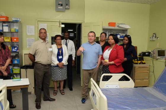 Minister of Public Health, Volda Lawrence taking a tour of the Pediatric Ward accompanied by Pediatric Cardiologist of BHF, Dr. Rodrigo Soto