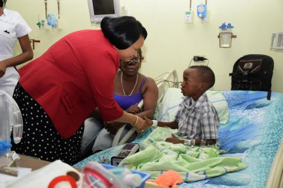 Minister of Public Health, Volda Lawrence meets with young Micko Alves who will be discharged shortly from the pediatric ward