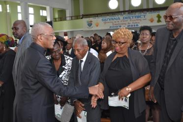 H.E. President David Granger greeting relatives and friends of the late Sandra Jones