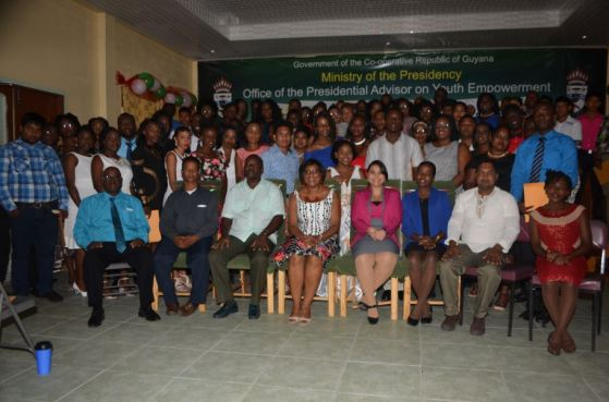 Minister of Public Communication Cathy Hughes (fourth left) and Presidential Advisor of Youth Empowerment Aubrey Norton (third left), pose with the graduates of the Youth Leadership Program and the Madewini Training Centre on Sunday
