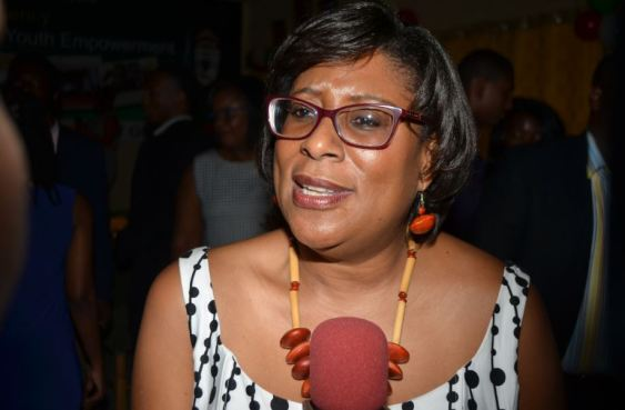 Minister of Public Telecommunication Cathy Hughes