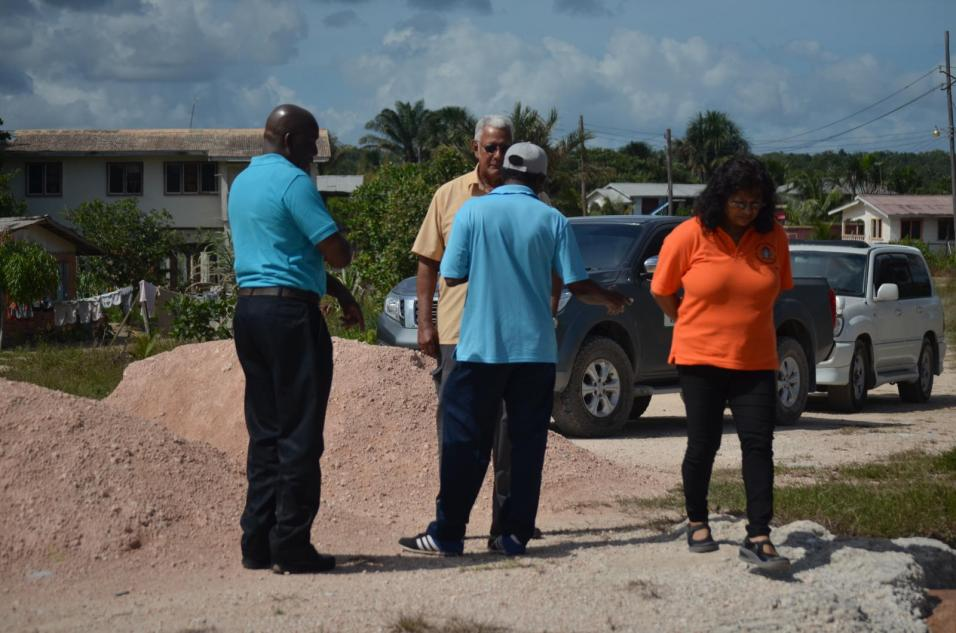 Minister Holder and team conduct assessment of the community
