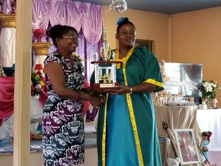 Evete Mc Bean Hawker, second in the region accepts her prize from Jennifer Cumberbatch