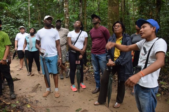 Kendrick Andrew leading Public Telecommunications Minister, Hon. Catherine Hughes and her team during a tour of Iwokrama Rainforest
