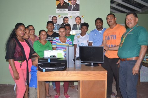 Minister of Indigenous Peoples' Affairs, Sydney Allicock handing over the equipment to youths of Aranaputa in the presence of Chairman of the Community, Adon Jacabus
