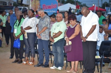(From right) Minister of State, Joseph Harmon, Minister of Social Protection, Amna Ally, Regional Executive Officer of Region Three, Dennis Jaikaran, Minister of Business, Dominic Gaskin and Minister within the Ministry of Natural Resources, Simona Broomes observe a moment of prayer during the opening of the exhibition