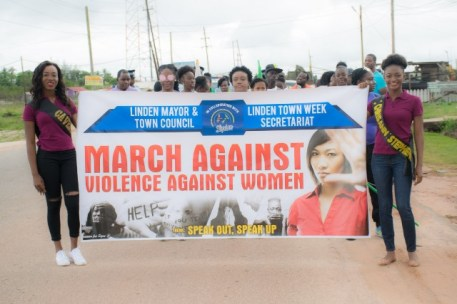 Participants hold the banner of the march