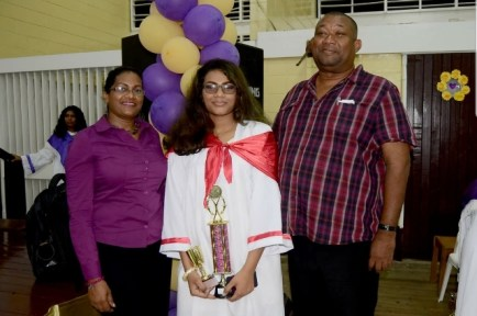 Marissa Foster on her graduation at New Amsterdam Multilateral Secondary School along with her parents Mr. and Mrs. Hilbert Foster