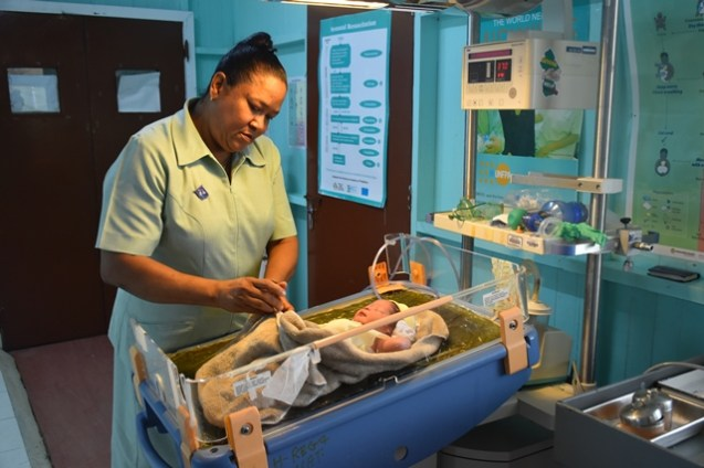 Nurse Patricia Smith conducting check-ups in the Neo-natal Intensive Care Unit (NICU)