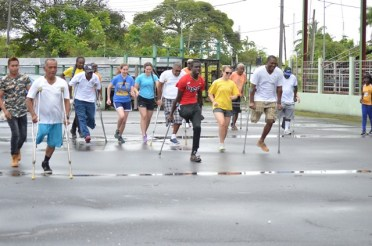 Persons with disabilities being treated to a day of sports d at the National Park Tarmac