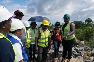 Minister Broomes addressing Toolsie managers on safety compliance