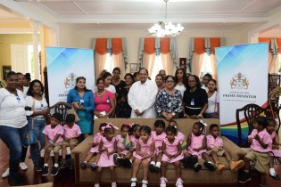 Prime Minister, Hon. Moses Nagamootoo and Mrs. Sita Nagamootoo with teachers, parents and students of the Little Angels Play Group.