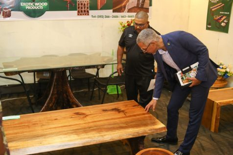 Minister of Business Dominic Gaskin inspects a table