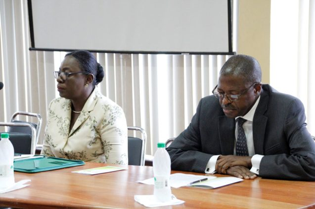Minister of Education, Hon. Nicolette Henry seated at the head table with ILO Specialist, Dr. Hassan Ndahi