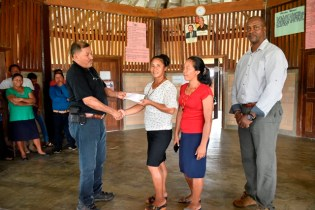 The Wowetta Women's Agro-processing receiving their cheque from Minister of Indigenous Peoples' Affairs, Sydney Allicock.
