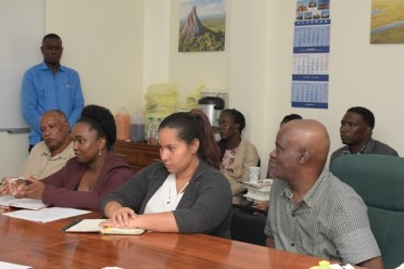 Members of the Bartica Neighborhood Democratic Council (NDC) discussing the way forward with current mining concerns in the region .