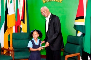 Miss Kaylin Klass presented President David Granger with a special card.