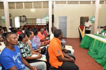 Minister of State, Mr. Joseph Harmon addressing residents of Kildonan and surrounding communities at the Kildonan Community Centre.