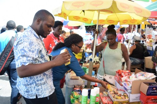 Staff of the M&CC examining goods at the Stabroek Market Bazaar.
