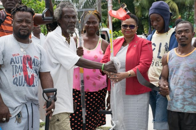 Minister of Public Health, Volda Lawrence, and residents with the donated tools.