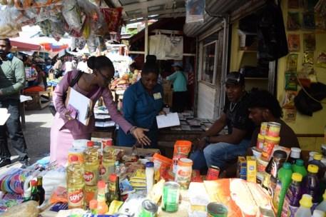 Staff of the M&CC examining goods at the Stabroek Market Bazaar.