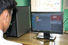 One of the STEM students working on a scratch code.