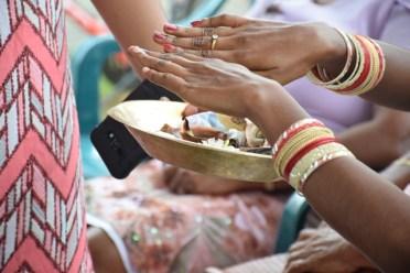 Ramesh 'Ravo' Sancharra's son fulfilling his duties as the eldest between his siblings as he performs the Hindu rites (Antyeshthi).