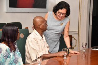 First Lady Mrs. Sandra interacting with a senior staff, Mr. Cedric Clarke at the Pre-Father`s Day Celebration held at State House.