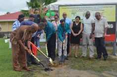 The sod being turned to officially launch the construction of the testing centre by (from left to right) Prof, Michael Scott, Professor Ivelaw Griffith, Mohin Persaud, Gomathinayagam Subramanian, while other university and company officials look on.