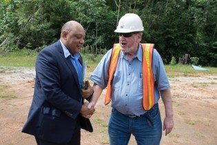 Minister of Natural Resources, Raphael Trotman greets Troy Resources' CEO, Ken Nilsson.