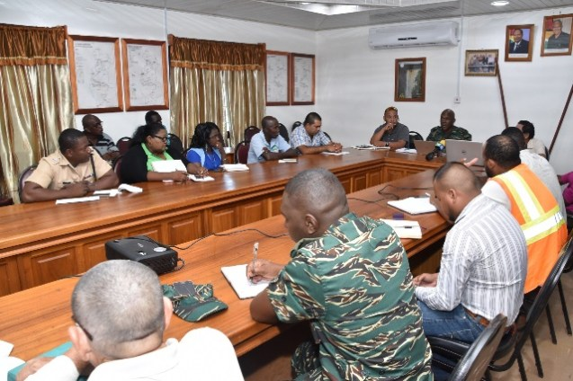 Director General of the Civil Defence Commission (CDC), Lieutenant Colonel Kester Craig (centre, head of table) regional and administrative officials from Government ministries, agencies and organs at the Regional Democratic Council boardroom.