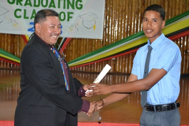 Daniel Henry, Santa Rosa, Region One receiving his certificate from the Minister of Indigenous Peoples' Affairs, Sydney Allicock.