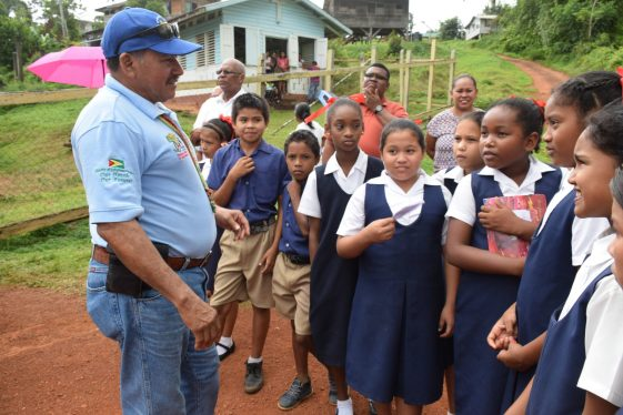 Minister of Indigenous Peoples' Affairs, Sydney Allicock interacting with the students