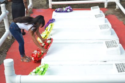 Relatives of the Enmore Martyrs laying a wreath at the grave site of the Enmore Martyrs