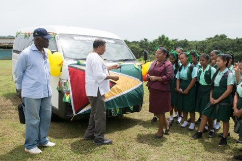 Minister of Indigenous Peoples' Affairs, Sydney Allicock handing over the bus to the Port Kaituma Secondary School.