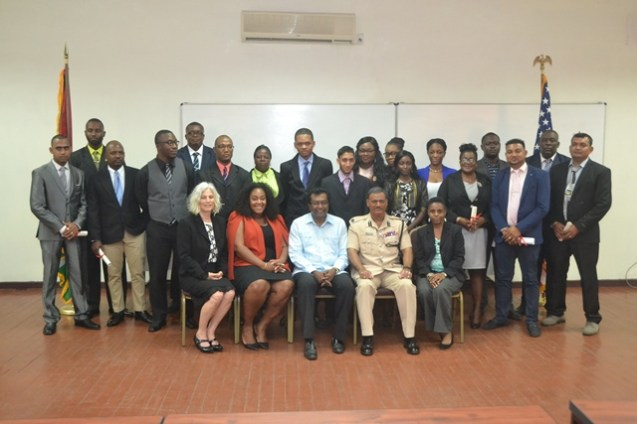 Minister of Public Security Khemraj Ramjattan, US embassy Political and Economic Chief, Alexandra King and Acting Police Commissioner David Ramnarine with the new Key Opinion Leaders.
