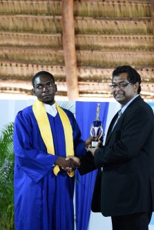 Second runner-up Ezekiel Roache receiving his trophy from Minister of Public Security, Khemraj Ramjattan
