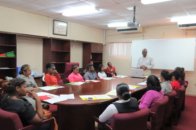 Dr. Colin James, Coordintor- EOC address participants at Food Handlers Trainining.