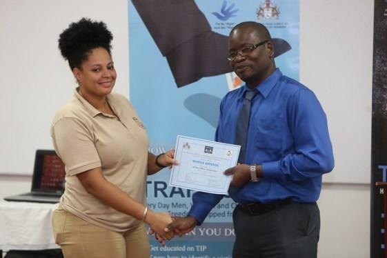 Mines Officer receiving her certificate.
