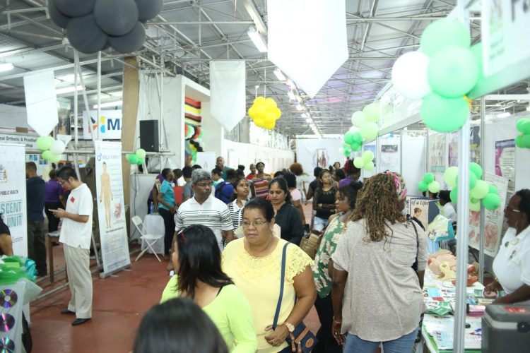 Patrons passing through viewing booths at the Health Expo