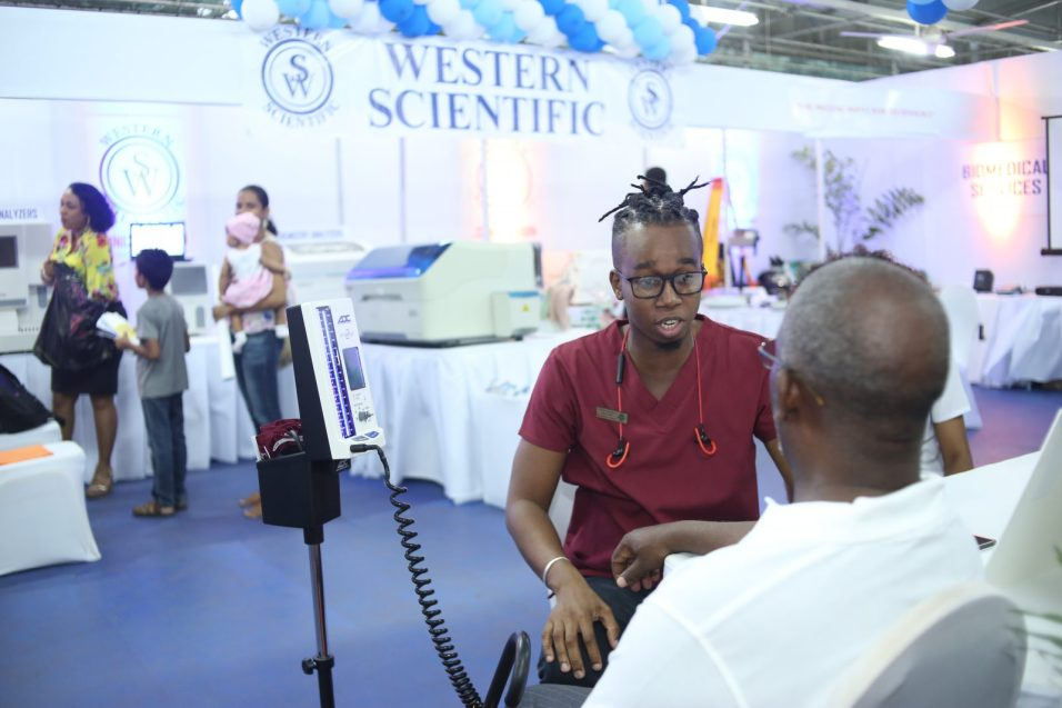 Ministry of Public Health staff listens keenly to counsel given by a medical professional as he gets his blood pressure checked