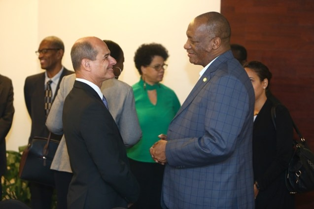 Minister of State, Joseph Harmon in conversation with Cuba's Vice Foreign Minister, Rogelio Sierra Diaz.
