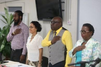 The panel preparing to recite the national pledge.