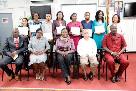 (Seated from right): Permanent Secretary within the Ministry of Education, Mr. Vibert Welch, Cuban Ambassador to Guyana, His Excellency, Narciso R. A. Socorro, Minister of Education, Hon. Nicolette Henry, Permanent Secretary within the Ministry of Public Health, Ms. Colette Adams and Chief Education Officer, Mr. Marcel Hutson posing for a photo opportunity with the graduates (Standing from right): Ms. Yolanda Williams, Ms. June Herod, Mr. Keenan Benjamin, Ms. Michelle Nicholas, Ms. Kalina Phillips, Mr. Calvin Lawirie, Ms. Mycinth Robertson and Ms. Kelly Coojah.