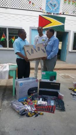 Lemond Emmanuel, Toshao of Assakata receiving the equipment from Minister Allicock.