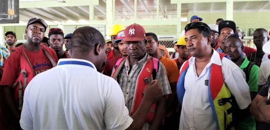 Oldendorff Carriers Guyana Inc. workers lisenting to Senior Labour Officer Dexter Semple