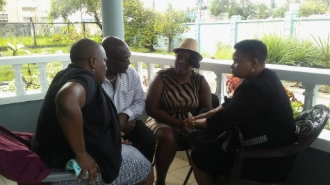 Minister of Public Health, Volda Lawrence and her team from the ministry sit with Jaqueline Allen-West, the mother of the brothers killed in the Den Amstel accident.